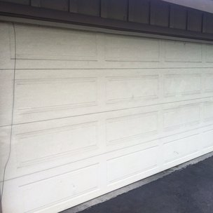 Hey Close Up View Of The Garage Door To Be Repaired. Can You See The